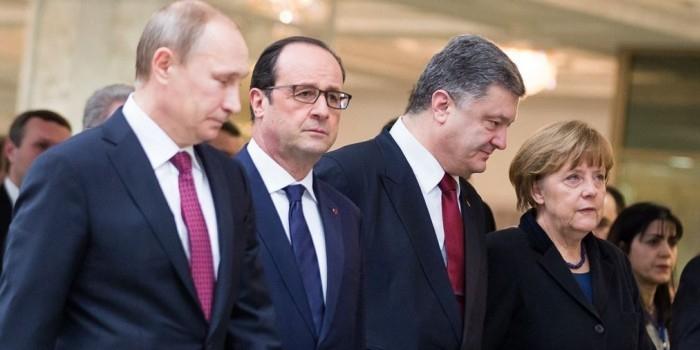 Путин и Порошенко обменялись рукопожатиями