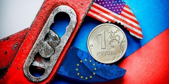 """МВФ: """"Война санкций"""" будет стоить России до 9% ВВП"""