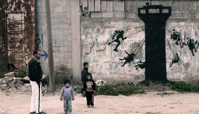 «Мы не остаемся нейтральными»: Бэнкси нарисовал граффити в секторе Газа