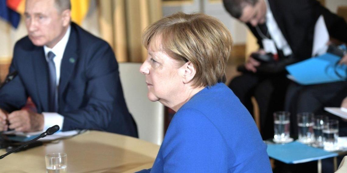 Меркель назвала Путина победителем на саммите в Париже