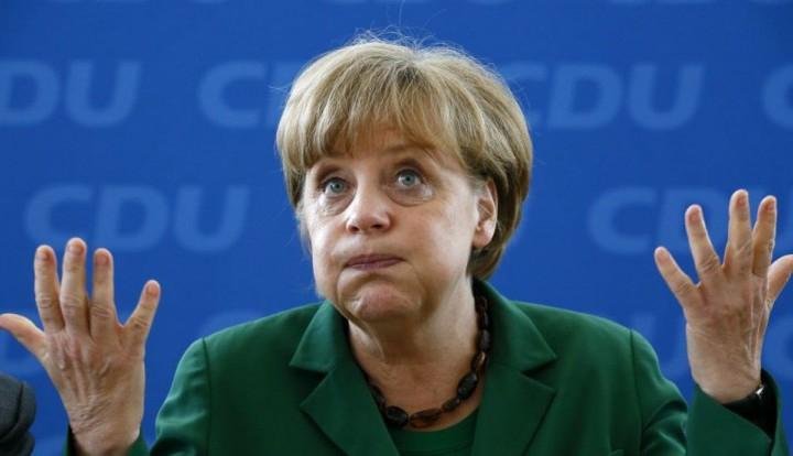 Меркель подгоняет Киев уплатить за газ, но МВФ денег не дает